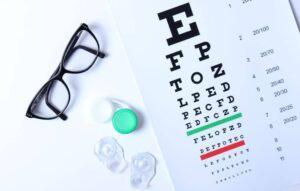 Contact lenses, eyeglasses and eye chart.